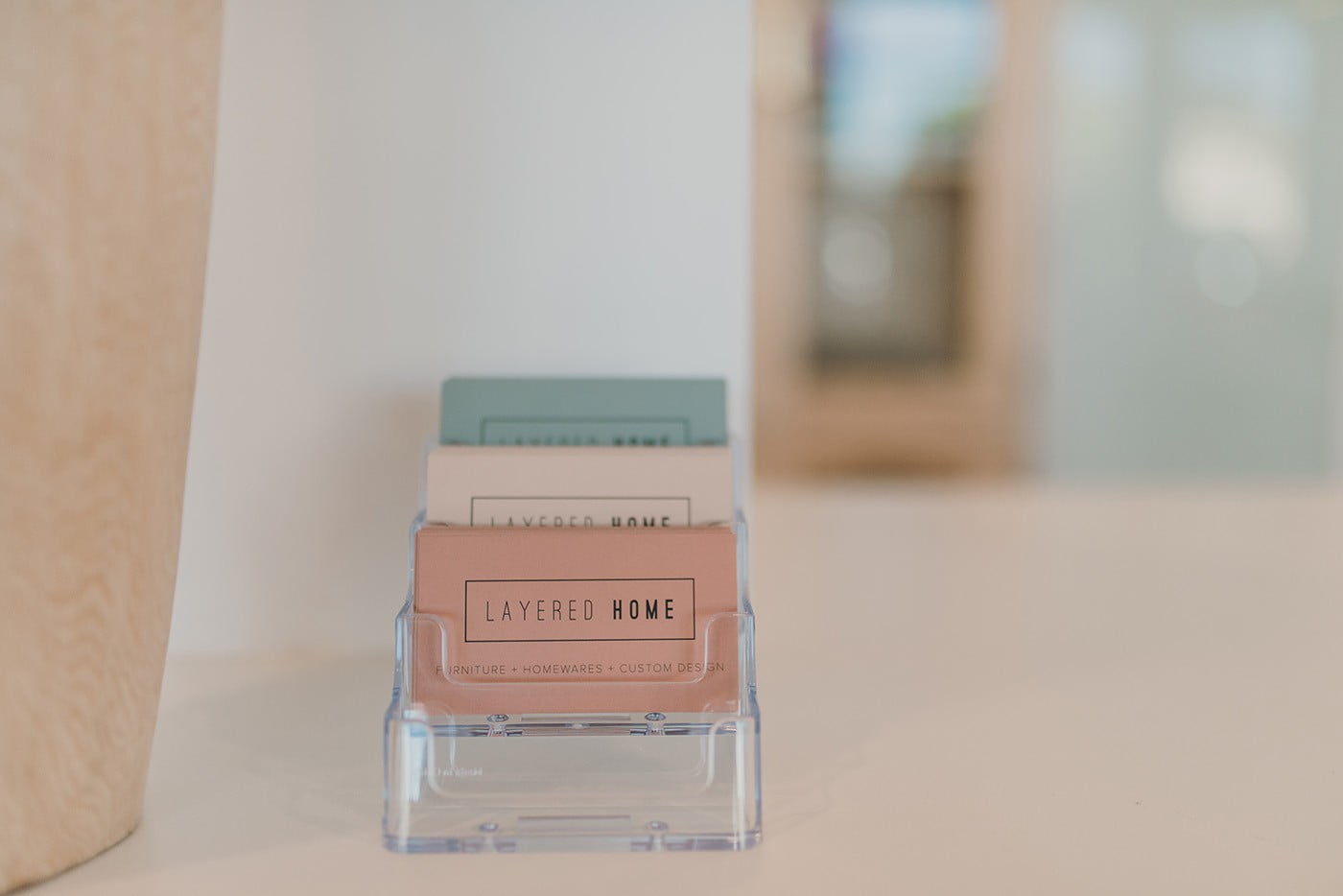 coloured business cards in a holder