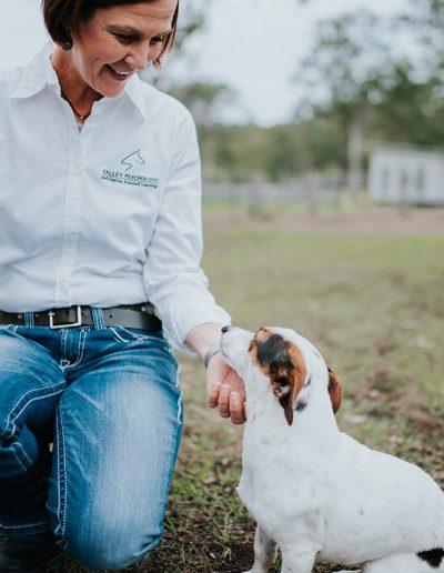 a woman patting a dog